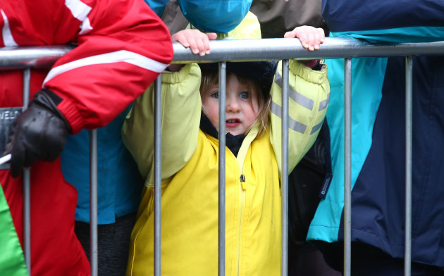 A young spectator watching the action