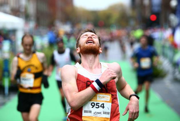 A competitor reacts after crossing the finish line