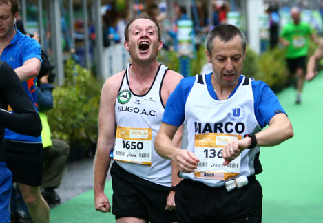 A competitor reacts after finishing the Dublin City Marathon