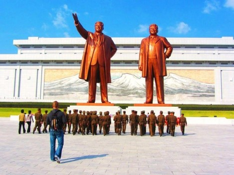 they-also-visited-the-dear-leader-right-and-great-leader-left-statues-in-pyongyang-which-feature-statues-of-kim-jong-il-and-his-father-kim-il-sung-justin-and-anna-were-required-to-bow-before-the-massive-statu