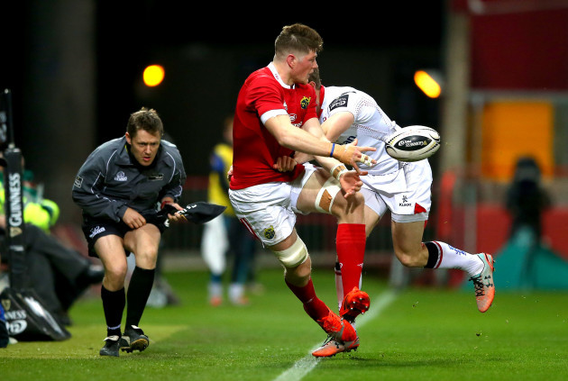 Jack O'Donoghue tackled by Andrew Trimble