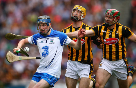 Austin Gleeson under pressure from Colin Fennelly and Kieran Joyce