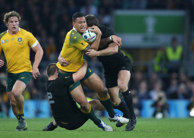 Israel Folau is tackled by Dane Coles and Conrad Smith