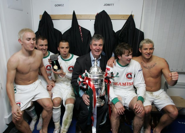 Damien Richardson celebrates with players in the dressing room after the game 2/12/2007