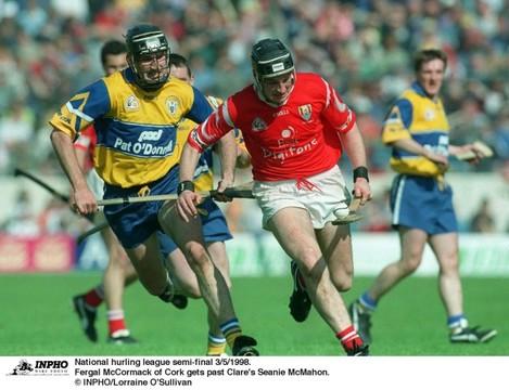 Fergal McCormack of Cork gets past Clare's Seanie McMahon