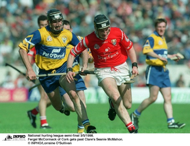 Fergal McCormack of Cork gets past Clare's Seanie McMahon