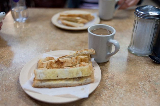 cuba-the-typical-breakfast-tostada-grilled-buttered-bread-is-served-alongside-or-dunked-into-cafe-con-leche