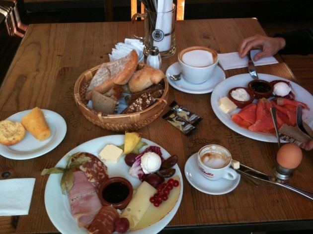 germany-germans-dig-into-an-assortment-of-fresh-breads-cold-meats-local-cheeses-butter-and-jam