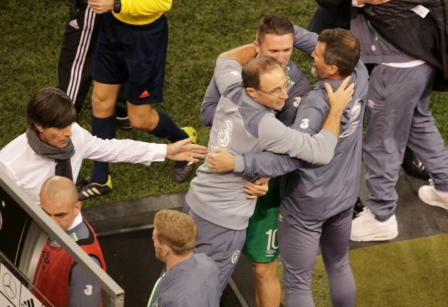 Martin O'Neill, Robbie Keane and Roy Keane celebrate the final whistle as Joachim Low congratulates them