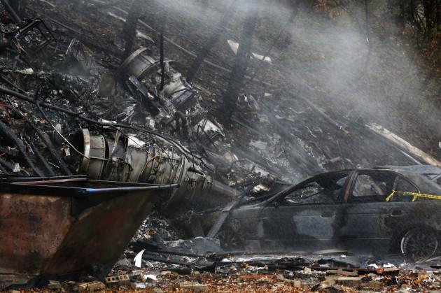 APTOPIX Plane Crash-Apartment Building
