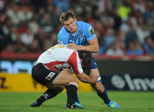 CJ Stander of the Bulls tackled by Callie Visagie of the Lions CJ Stander will be joining Munster 21/6/2012