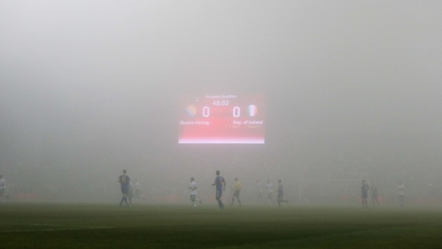 A view of the match as a thick fog covers the pitch