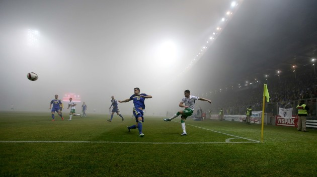 Robbie Brady clears as a thick fog covers the pitch