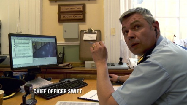 The Joy on TV3 - Ep 3 - In Picture: Chief Officer Swift looking at CCTV footage of prisoner attacking officer with brush