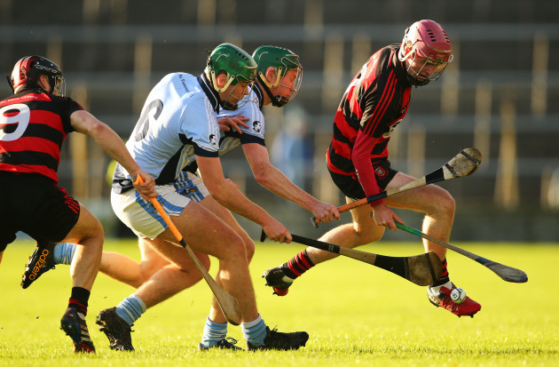 Billy OÕKeefe under pressure from Ronan Lynch and Will OÕDonoghue