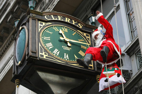 Santa abseils past Clery's Clock