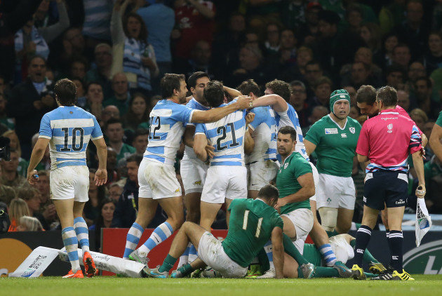 Argentina celebrate their third and decisive try as Dave Kearney and Rob Kearney look on