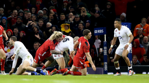 George North falls to the ground injured following a collision with Mike Brown
