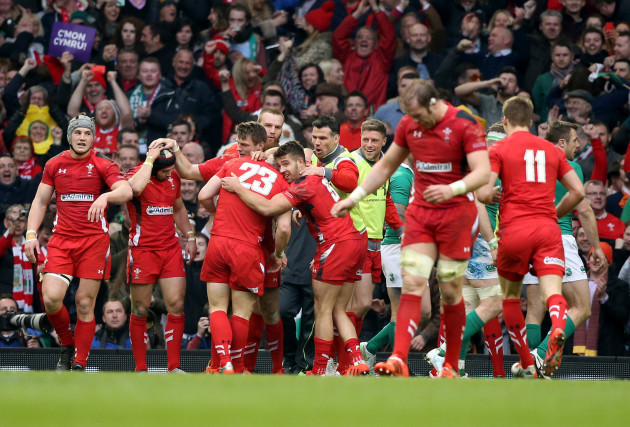 The Wales team celebrate Scott William's try