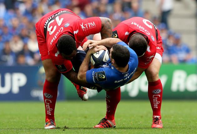 Mathieu Bastareaud and Guilhem Guirado tackle Rob Kearney