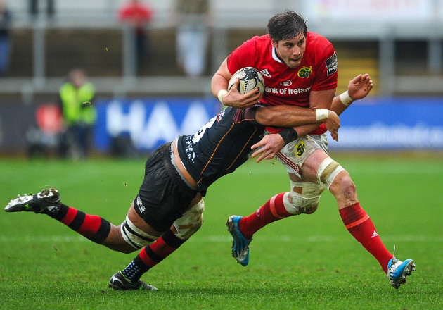 Dave O'Callaghan is tackled by Taulupe Faletau