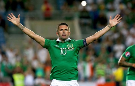 Robbie Keane celebrates scoring their third goal from the penalty spot