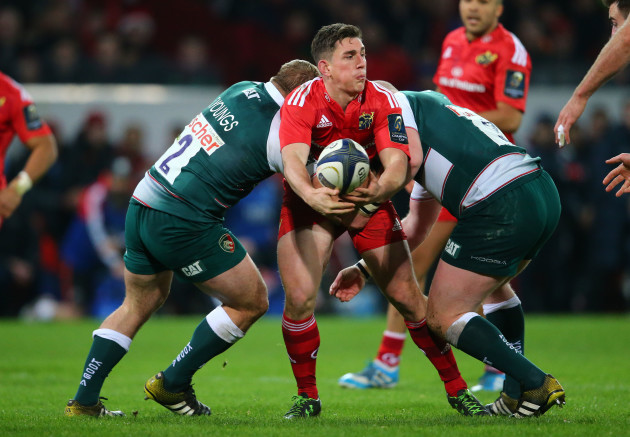Ian Keatley is tackled by Tom Youngs and Dan Cole