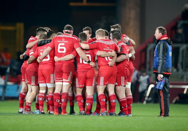 Munster players out early for the second half in a huddle
