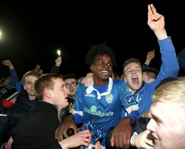 Finn Harps match winner BJ Banda swamped by fans at the final whistle
