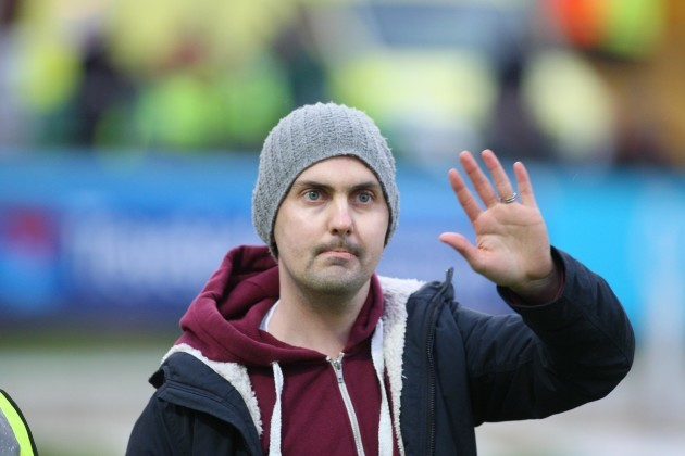 Mark Farren is applauded by the crowd at half-time
