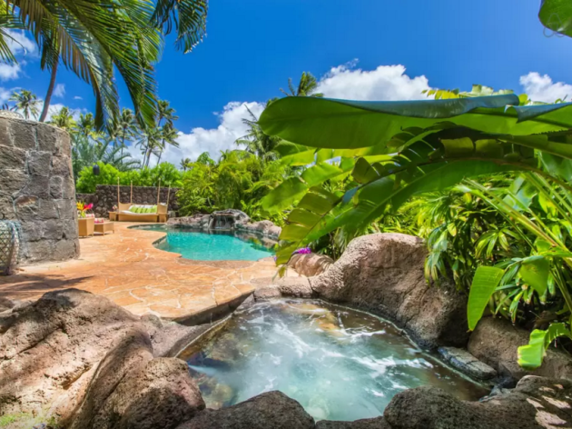 for-that-price-tag-guests-enjoy-a-hot-tub-pool-and-a-five-minute-drive-to-the-famous-waikiki-beach-the-house-has-three-bedrooms-and-accommodates-up-to-six-people
