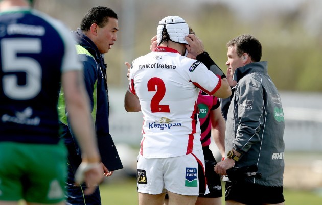 Pat Lam and Rory Best speak to Nigel Owens at the start of the game