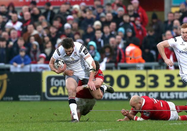 Stuart McCloskey tackled by Jack O'Donoghue