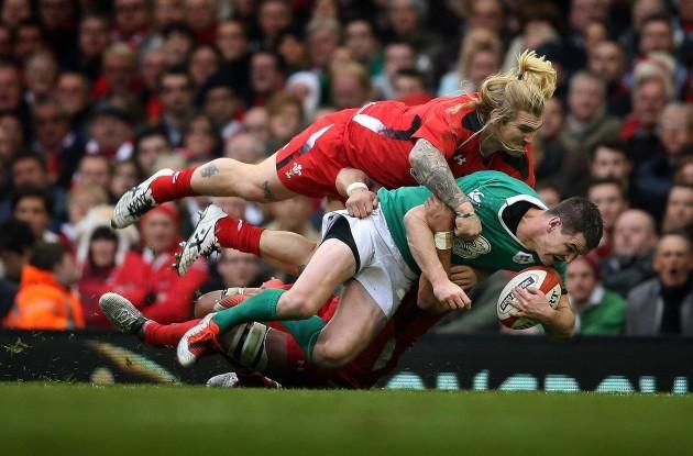 Jonathan Sexton tackled by Richard Hibbard