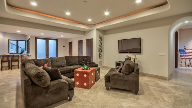 downstairs-a-bar-area-complements-the-family-room