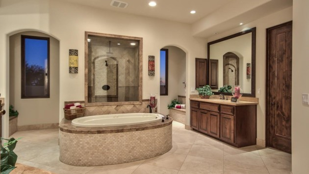 a-jacuzzi-tub-stands-in-the-center-of-the-master-bath