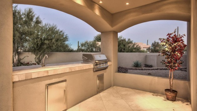 theres-a-built-in-grill-among-the-appliances-of-the-outdoor-kitchen
