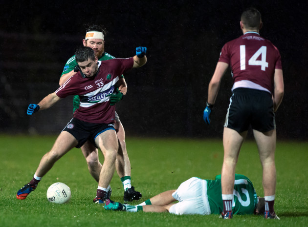 Patrick McBride under pressure as James McMahon lies injured