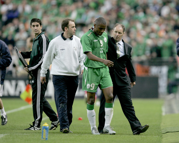 Clinton Morrison is consoled by Brian Kerr