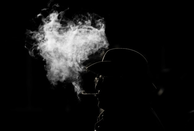 A general view of a racegoer smoking a cigar at Thurles Racecourse