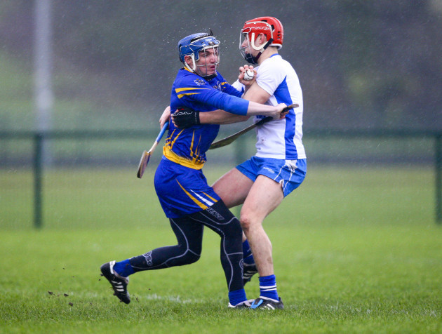 Donal Tuohy is tackled by Seamus Keating