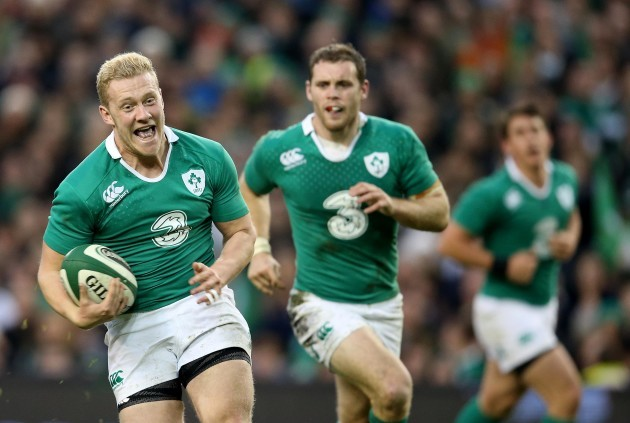 Stuart Olding runs in for a try