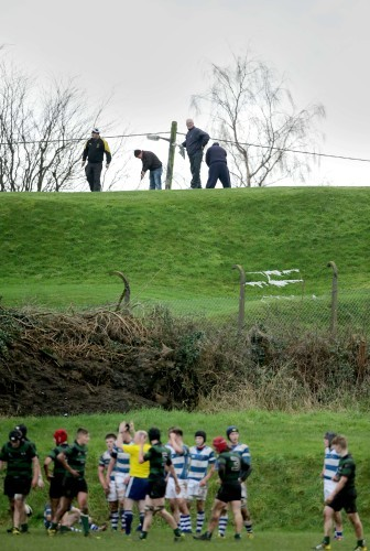 Golfers from a nearby course watch the game between Rockwell and Bandon