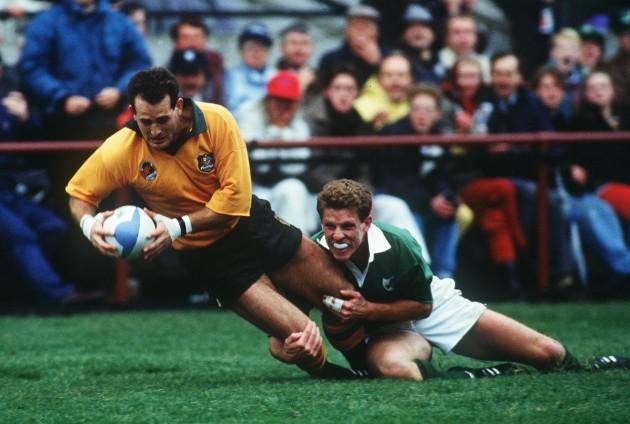 David Campese is tackled Brendan Mullin