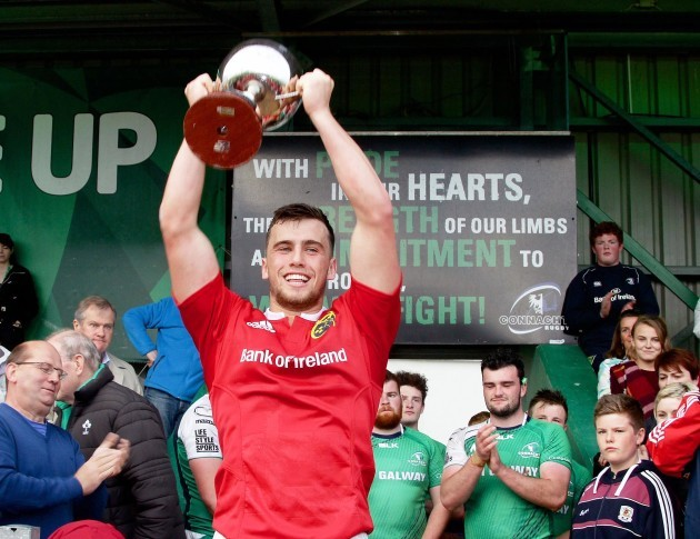 Paul Kiernan lifts the cup
