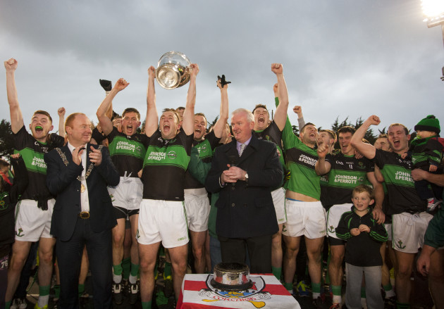 Paul Kerrigan lifts the trophy