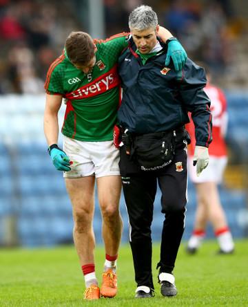Lee Keegan is helped from the field by Dr. Sean Moffatt