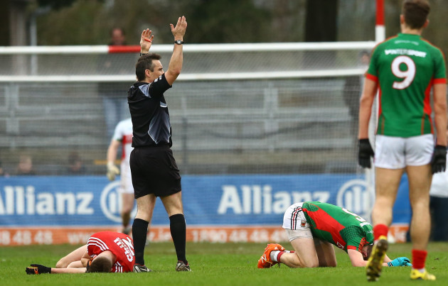 Eoin Cadogan and Lee Keegan following a head collision