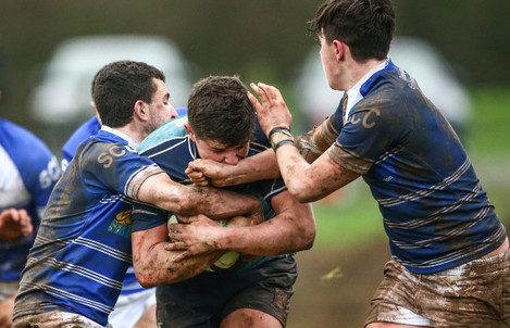 Eoin Murnane and Aidan Quinlavan tackle Joseph Conway
