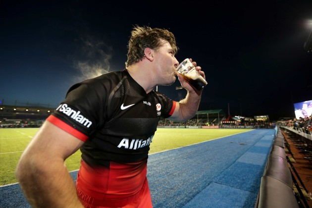 Schalk Brits takes a pint from someone in the crowd, takes a drink then hands it back